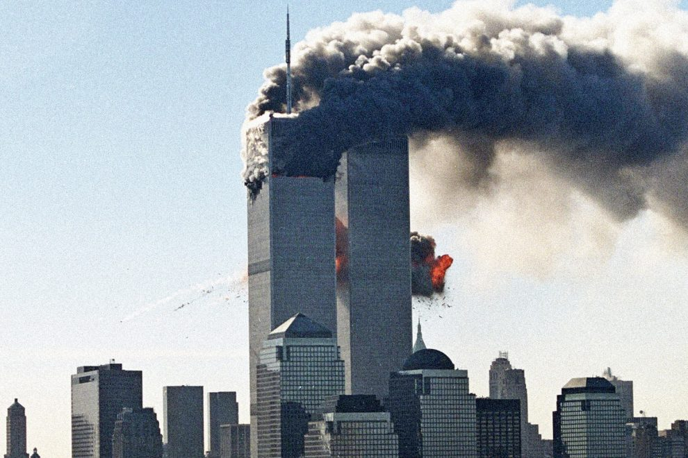 11 Sep 2001, New York City, New York, USA --- The second hijacked plane is seen as it hits the second tower of the World Trade Center. --- Image by © Masatomo Kuriya/Corbis